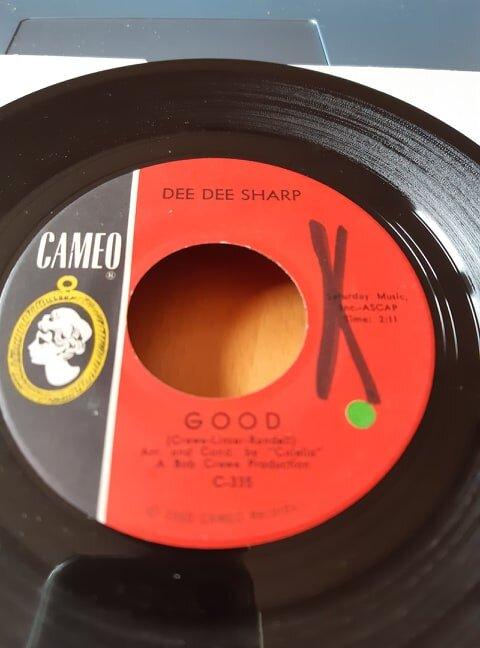 DEE DEE Sharp Good label with x written on.jpg